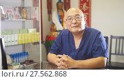 Купить «Portrait of a doctor of tibetan medicine - senior bold medicalpractitioner», фото № 27562868, снято 27 апреля 2018 г. (c) Константин Шишкин / Фотобанк Лори