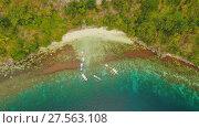 Купить «Aerial view Sunset and Atwayan beach with rocks. Travelling tour in Asia: Palawan, Philippines.», видеоролик № 27563108, снято 4 февраля 2018 г. (c) Mikhail Davidovich / Фотобанк Лори