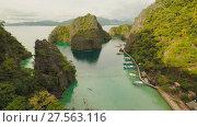 Купить «Very beautyful lagoon with boats. Paradise islands in Philippines. Kayangan Lake.», видеоролик № 27563116, снято 4 февраля 2018 г. (c) Mikhail Davidovich / Фотобанк Лори