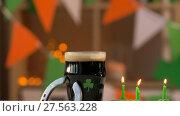 Купить «glass of beer, cupcakes, horseshoe and gold coins», видеоролик № 27563228, снято 1 февраля 2018 г. (c) Syda Productions / Фотобанк Лори