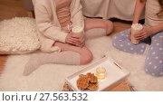 Купить «happy female friends at home pajama party», видеоролик № 27563532, снято 25 января 2018 г. (c) Syda Productions / Фотобанк Лори