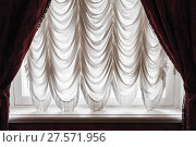 Купить «Waving tulle and dark red curtain on window», фото № 27571956, снято 15 октября 2017 г. (c) EugeneSergeev / Фотобанк Лори