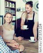 Купить «polite waiter girl brought cup of coffee for couple of different aged people», фото № 27573224, снято 22 апреля 2017 г. (c) Яков Филимонов / Фотобанк Лори