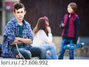 Купить «Teen took offence at friends», фото № 27606992, снято 21 апреля 2019 г. (c) Яков Филимонов / Фотобанк Лори
