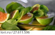 Купить «Basil leaves falling on cut green figs», видеоролик № 27611596, снято 1 ноября 2017 г. (c) Данил Руденко / Фотобанк Лори