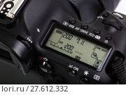 Купить «Professional modern DSLR camera - detail of the top LCD with settings - shutter speer, aperture, ISO, AF mode, battery info, RAW format indication,...», фото № 27612332, снято 26 июня 2019 г. (c) PantherMedia / Фотобанк Лори