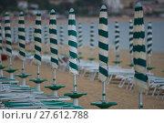 Купить «Row of Beach Umbrellas», фото № 27612788, снято 20 февраля 2019 г. (c) PantherMedia / Фотобанк Лори