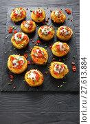 Купить «baked potatoes loaded with grated cheese», фото № 27613884, снято 3 февраля 2018 г. (c) Oksana Zh / Фотобанк Лори