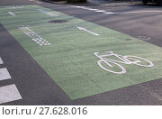 Купить «marking on asphalt for the first bicycle road in darmstadt (hessen,germany)», фото № 27628016, снято 14 октября 2019 г. (c) PantherMedia / Фотобанк Лори