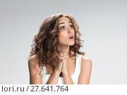 Купить «Portrait of young woman with shocked facial expression», фото № 27641764, снято 22 октября 2018 г. (c) PantherMedia / Фотобанк Лори