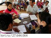 Купить «AMK microfinance and CARD disbursing funds for beneficiaries of a Unicef program.», фото № 27644064, снято 8 декабря 2019 г. (c) age Fotostock / Фотобанк Лори