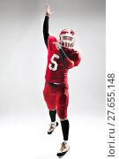 Купить «American football player posing with ball on white background», фото № 27655148, снято 11 декабря 2018 г. (c) PantherMedia / Фотобанк Лори