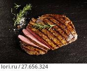 Купить «Roasted medium rare sliced flank beef with rosemary», фото № 27656324, снято 19 марта 2019 г. (c) PantherMedia / Фотобанк Лори