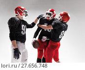 Купить «The three american football players posing on white background», фото № 27656748, снято 11 декабря 2018 г. (c) PantherMedia / Фотобанк Лори