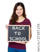Купить «Asian Young woman hold with chalkboard and showing phrase of back to school», фото № 27657216, снято 23 июля 2018 г. (c) PantherMedia / Фотобанк Лори