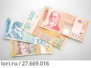 Купить «Serbian dinars displayed on white background», фото № 27669016, снято 27 апреля 2018 г. (c) PantherMedia / Фотобанк Лори