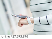 Купить «Woman connecting smart watch and cellphone», фото № 27673876, снято 21 июня 2018 г. (c) PantherMedia / Фотобанк Лори