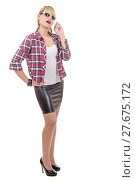 Купить «young woman clothed in a leather skirt and shirt, on phone», фото № 27675172, снято 17 августа 2018 г. (c) PantherMedia / Фотобанк Лори