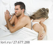 Купить «man kissing his partner sweetly in white bed», фото № 27677288, снято 14 ноября 2018 г. (c) PantherMedia / Фотобанк Лори