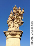 Купить « Statue of St Anne with the infant Jesus (by Matej Vaclav Jackel) on the North side of Charles Bridge, Prague, Czech Republic, Eastern Europe.», фото № 27683556, снято 27 марта 2019 г. (c) PantherMedia / Фотобанк Лори