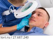 Купить «Female doctor is doing cleaning skin procedure to client», фото № 27687240, снято 20 октября 2018 г. (c) Яков Филимонов / Фотобанк Лори