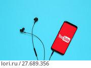 Купить «RUSSIA, Tyumen - February 10, 2018: Youtube application on mobile device. Flat lay.», фото № 27689356, снято 10 февраля 2018 г. (c) Евгений Глазунов / Фотобанк Лори
