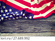 Купить «American flag on wooden background», фото № 27689992, снято 23 января 2019 г. (c) PantherMedia / Фотобанк Лори