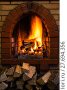 Купить «wood stack and logs burning in brick fireplace», фото № 27694356, снято 26 марта 2019 г. (c) PantherMedia / Фотобанк Лори