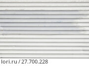 Купить «White dirty horizontal roller shutter blinds», фото № 27700228, снято 21 мая 2019 г. (c) PantherMedia / Фотобанк Лори