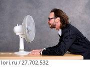 Купить «business man in dark suit sitting in front of ventilator», фото № 27702532, снято 19 марта 2019 г. (c) PantherMedia / Фотобанк Лори