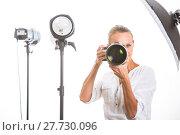 Купить «Pretty, female photographer with digital camera - DSLR and a huge telephoto lens (color toned image; shallow DOF)», фото № 27730096, снято 19 июля 2018 г. (c) PantherMedia / Фотобанк Лори