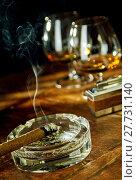 Купить «Tilted angle view of cigar sitting in ashtray», фото № 27731140, снято 25 апреля 2018 г. (c) PantherMedia / Фотобанк Лори