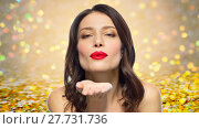 Купить «beautiful woman with red lipstick blowing air kiss», фото № 27731736, снято 5 января 2018 г. (c) Syda Productions / Фотобанк Лори