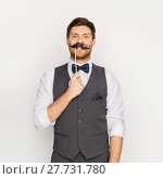 Купить «happy young man with fake mustache at party», фото № 27731780, снято 15 декабря 2017 г. (c) Syda Productions / Фотобанк Лори