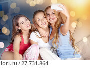 Купить «teen girls with smartphone taking selfie at home», фото № 27731864, снято 14 ноября 2015 г. (c) Syda Productions / Фотобанк Лори