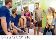 Купить «group of friends with sports equipment in gym», фото № 27731916, снято 19 февраля 2017 г. (c) Syda Productions / Фотобанк Лори