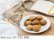 Купить «oatmeal cookies with almonds on plate at home», фото № 27731988, снято 15 ноября 2017 г. (c) Syda Productions / Фотобанк Лори