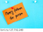 Купить «Money Follows The Person written on orange paper note», фото № 27732240, снято 17 июля 2019 г. (c) PantherMedia / Фотобанк Лори