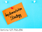 Купить «Implementation Strategy written on orange paper note», фото № 27732256, снято 25 февраля 2018 г. (c) PantherMedia / Фотобанк Лори