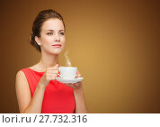 Купить «beautiful woman in red dress with cup of coffee», фото № 27732316, снято 1 июня 2014 г. (c) Syda Productions / Фотобанк Лори