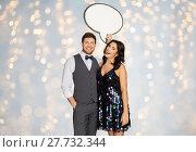 Купить «happy couple at party holding text bubble banner», фото № 27732344, снято 15 декабря 2017 г. (c) Syda Productions / Фотобанк Лори