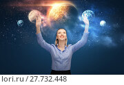 Купить «happy businesswoman with virtual planets and space», фото № 27732448, снято 17 ноября 2012 г. (c) Syda Productions / Фотобанк Лори