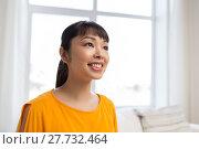 Купить «portrait of smiling young asian woman at home», фото № 27732464, снято 9 марта 2016 г. (c) Syda Productions / Фотобанк Лори