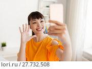 Купить «happy asian woman taking selfie by smartphone», фото № 27732508, снято 9 марта 2016 г. (c) Syda Productions / Фотобанк Лори