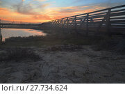 Купить «Wooden Boardwalk at sunset», фото № 27734624, снято 18 июня 2019 г. (c) PantherMedia / Фотобанк Лори