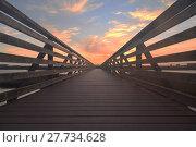Купить «Wooden Boardwalk at sunset», фото № 27734628, снято 18 июня 2019 г. (c) PantherMedia / Фотобанк Лори
