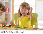 Купить «kids playing with developmental toys at home or kindergarten or daycare center», фото № 27736792, снято 19 сентября 2018 г. (c) Оксана Кузьмина / Фотобанк Лори