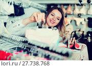 Купить «Woman client choosing brassiere in underwear store», фото № 27738768, снято 20 марта 2017 г. (c) Яков Филимонов / Фотобанк Лори