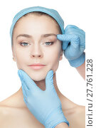 Купить «Plastic surgery concept. Doctor hands in gloves touching woman face», фото № 27761228, снято 17 ноября 2018 г. (c) PantherMedia / Фотобанк Лори