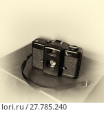 Купить «Vintage camera with strap bokeh background», фото № 27785240, снято 26 апреля 2018 г. (c) PantherMedia / Фотобанк Лори